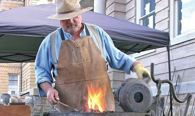 Blacksmith Mark Ramsey attracted crowds to the county courthouse lawn Saturday, demonstrating his craft at the Wise Fall Fling.  JEFF LESTER PHOTO