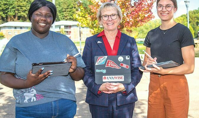 UVA Wise senior Naya Davis, Chancellor Donna P. Henry and senior McKenzie Dkystra pose with their iPads.  UVA WISE PHOTO