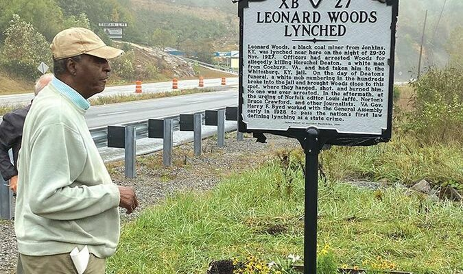 Frank Gravely of Norton stands beside the new marker.  HANNAH REXRODE PHOTO
