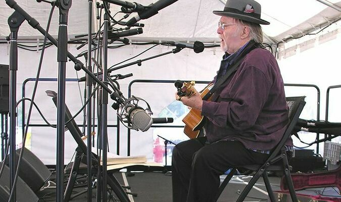 Jack Wright, local native and traditional musician, performs coal mining songs Saturday at Home Craft Days. The festival returned to the Mountain Empire Community College campus after being cancelled in 2020 due to COVID-19 concerns.   JEFF LESTER PHOTO