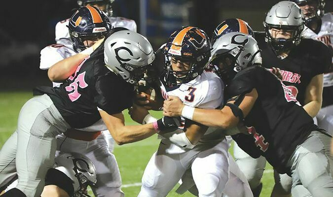 Aiden Bowman (85) and Logan Mullins (44) helped hold Union to less than 50 yards rushing on the night. PHOTO BY DONNIE RATLIFF