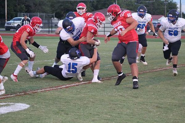 Comanche's Bryson Evans tries to break through a tackle in the first quarter in the Indians' 34-12 win over Healdton last Friday.