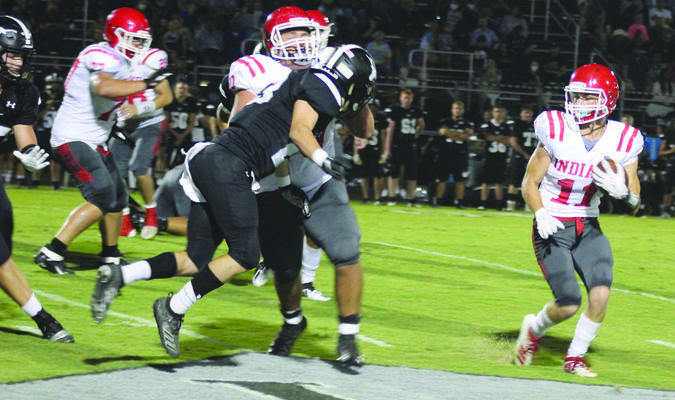 Comanche running back Gage Allie picks up a big block from Justin Jameson against Lone Grove last Friday.