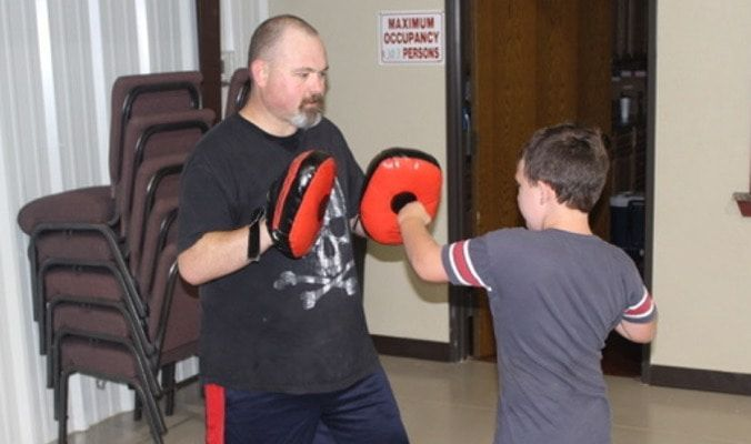 Keith Hampton works with a Warrior Journey student in June 2019.