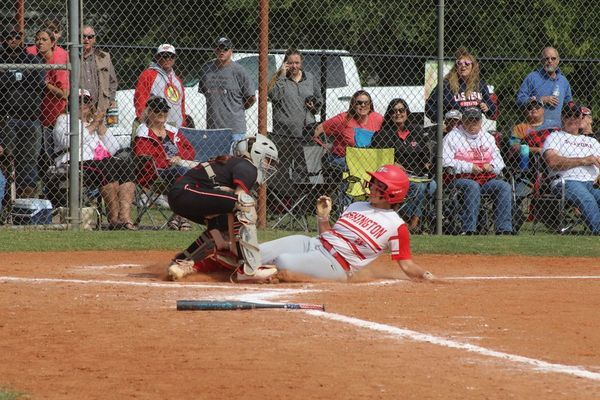 Comanche catcher Mykayla Slovak tags out a Washington base runner in the regional championship game on Friday.