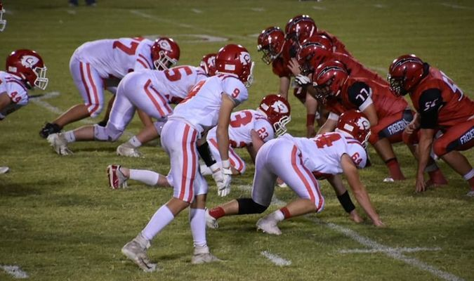 The Comanche defense lines readies for the snap against Frederick (Photo by Brooke Evans)