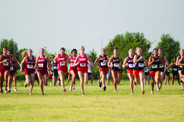 Jaylee Miller, Ryleigh Woody and Sarai Alvarez take off from the starting line at the Duncan cross country meet last Saturday. Miller placed first in the race.