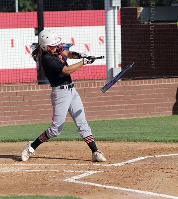 Kinley Rendon breaks her bat after hitting a ball in the Lady Indians' 11-1 win over Lindsay on Monday. (Photo by Todd Brooks)