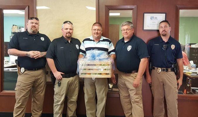 L-R Officer Matt tucker, Officer Jonathan Powell, Lieutenant Greg Miller, Chief Jim Tucker and Sergeant Brad Bazarrow with the fruit basket.