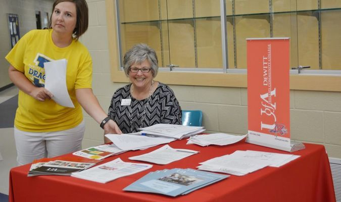 Diana Graves helping hand out papersfor the college. Parents can always go back to school and PCCUA is the best place to start!