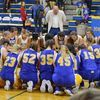 Dragonettes and Des Arc praying together after hard fought game.