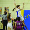 Carrington Hollimon goes up to block shot against Stuttgart, while Lillie Thomason awaits rebound