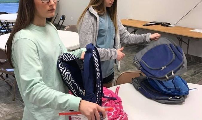 Shelby Long and Makayla Whiting fill backpack for foster kids.