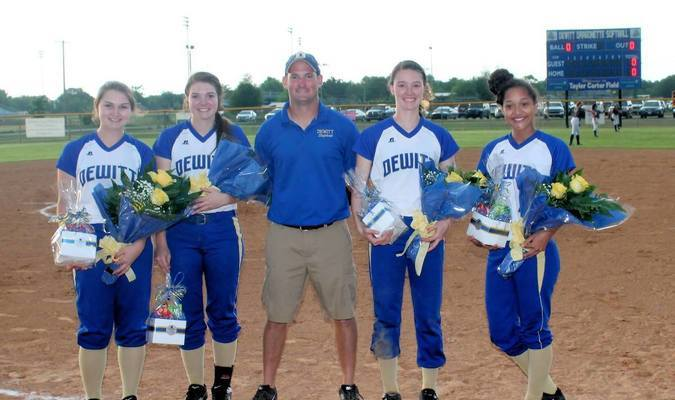 DeWitt Dragonette Softball Seniors, #14 Anna Clawson, #13 Kyla Patterson, #12 Libby Cox, and # 2 Tori Douglas with Coach Michael Lewis and the roses he presented to the senior players.