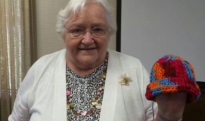 Betty and her crocheted hat for Arkansas Children's Hospital