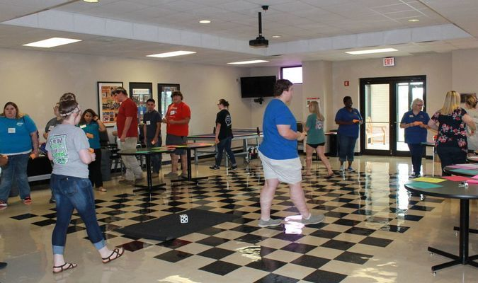 Students participate in the game of LIFE as faculty members Shawanna Wansley and Tracie Karkur walk them through the scenarios of college life