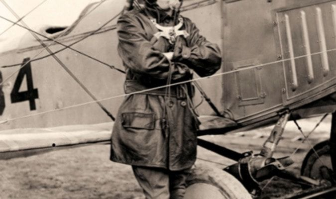 This photograph was taken in 1918 at Ebert's Field.Ebert's Field was established in 1917, in Lonoke, Arkansas, around thirty miles from Stuttgart. It served asone of the leading training centers for aviators during World War I.  Itshows pilot with microphone receiving helmet and power generated radio telephone.  Image courtesy of Arkansas State Archives