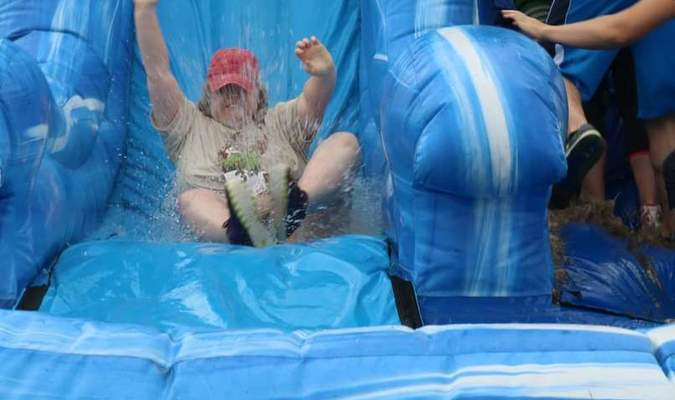Emily Golden splashes into the adventure run at the first obstacle - the water slide.