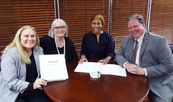 Announcing the largest grant ever received by PCCUA are (L-R) grant writer Dr. Linda Heard, PCCUA Vice Chancellor Dr. Deborah King, PCCUA GEAR UP Director Dr. Nichole Scarboro, and PCCUA Chancellor Dr. Keith Pinchback. The new GEAR UP grant totals $8,456,000 over the next seven years. (Marla Riddell photo)