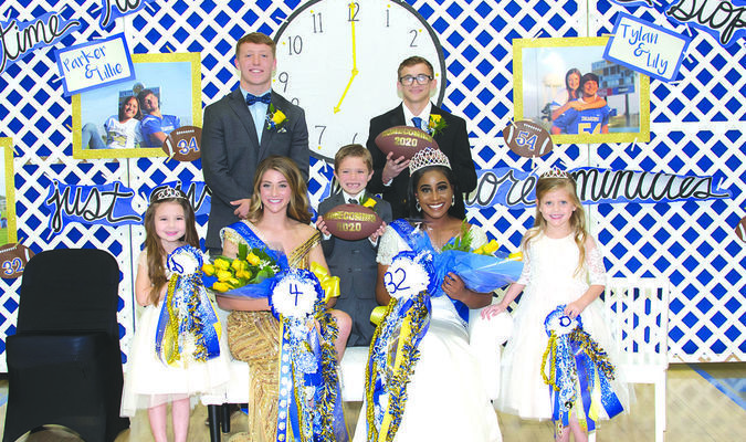 L-R: Mascot Emma Mannis, Homecoming Maid Carrington Hollimon escorted by #4 Logan Moss, Mascot Townsend Cotten, Homecoming Queen Paige Howard escorted by #32 Hunter Downing, Mascot Greenley Dondanville.