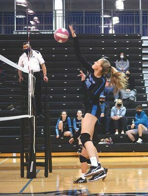 Hailey Sutherland goes skyward to slam down 10 kills for the Lady Wolfpack Monday. KELLEY PEARSON PHOTO