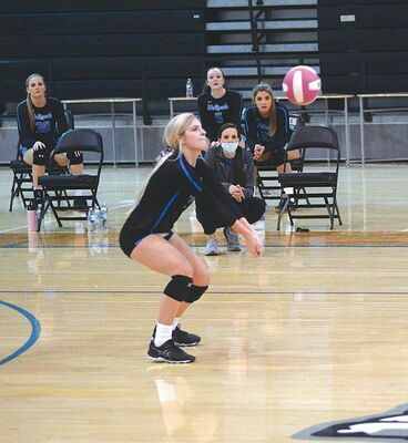 Hailey Pease digs this kill as the Lady 'Pack outlasted Union. KELLEY PEARSON PHOTO