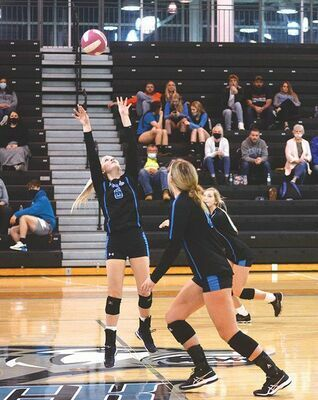 The Ridgeview offense was a well-oiled machine Monday night as Alyssa Price sets up her hitters. KELLEY PEARSON PHOTO