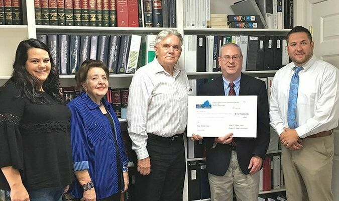 On hand for the loan closing, left to right, were county IDA Director Mitzi Sykes, IDA member Ginger Senter, IDA Chair Larry Yates, VCEDA chief executive Jonathan Belcher and Board of Supervisors Chair Josh Evans.  VCEDA PHOTO