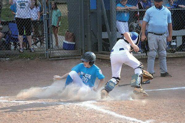 Brandon Beavers slides across home plate. PHOTO BY KELLEY PEARSON