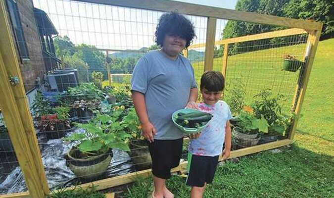 Rhett and Ryden Baker with some of their produce.