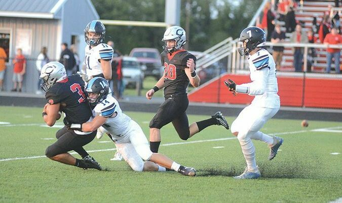 Ridgeview's Ian Hartsock catches up to Central quarterback Braeden Church to protect the shutout. PHOTO BY KELLEY PEARSON
