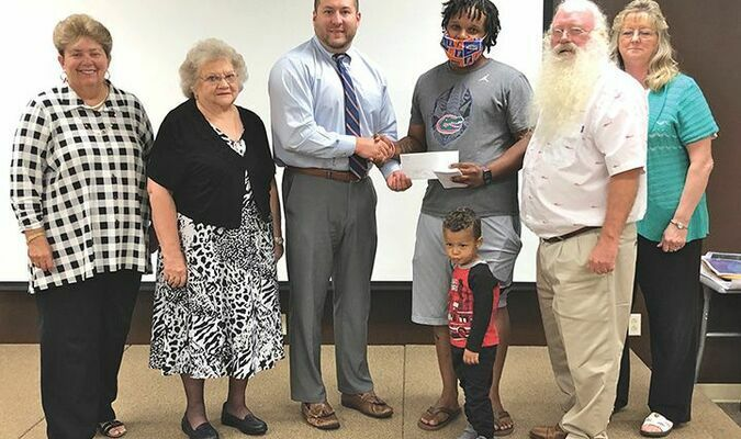Clinchco has received $51,040 from the county Board of Supervisors for a playground and recreation area expansion. Council member Jelane Mock, third from right, received the check from supervisors during their Sept. 28 meeting.  BOARD OF SUPERVISORS PHOTO