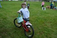 John Campbell Clark, 7, of Sedalia, was the winning ticket hold for a prize bike, in the age 7-10 category for boys.