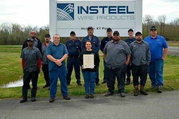 SAFETY AWARD – Insteel Wire Products of Hickman received the Governor's Safety and Health Award for achieving 250,000 hours of work without an injury. Members of Insteel of Hickman are shown in front of the company sign and the plaque received. (Photo by Barbara Atwill)