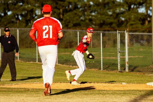Senior Red Devils Eli Carlisle and Cade Malray  saw their team record a win at home on Monday hosting Lake County's Falcons. (Photo by Jake Clapper)
