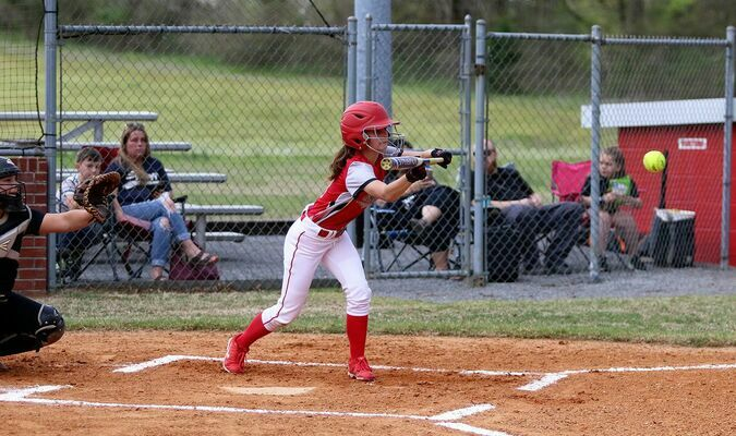 BATTER BUNT – South Fulton Lady Red Devil Aubree Gore goes for the bunt during Friday evening's home field match up against visiting Trenton. The Lady Devils came out on top, allowing just one run, and beating Trenton 11-1. (Photo by Jake Clapper)