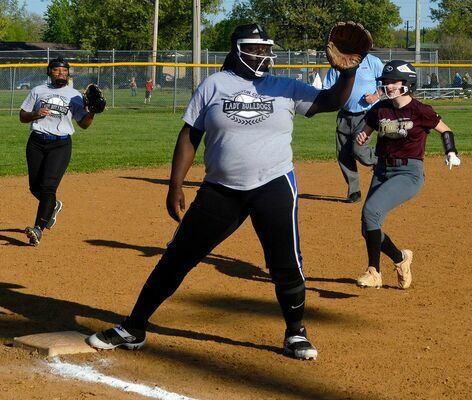 Lady Bulldog Takyra Taylor attempts the play at third, to stop a Lady Comet's advance.