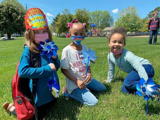 PINWHEELS FOR PREVENTION – Look for shiny objects on the grounds of Carr Elementary, Fulton Middle/High School, and Fulton Independent's board office. Pinwheels were planted by students, preschool through 12th grade to recognize April as Child Abuse Prevention Month. Pictured are, left to right, Carr Elementary students Ariana Green, Brylynn Ward, and Kynleigh Haynes. (Photo by Tracy Pulley, FRYSC Director)