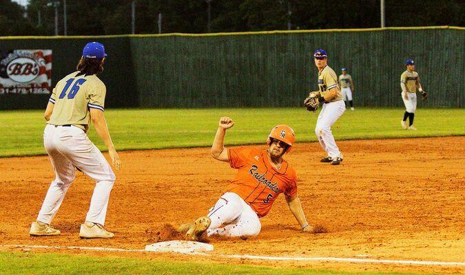 Fulton Railroader Parker Estes slides safely into third base vs. Muhlenberg County. (Photo by Jake Clapper)