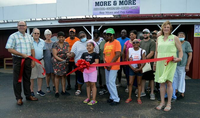 A large group of family, friends and Chamber members were on hand for last week's Ribbon Cutting for Lisa's More & More. (Photo by Benita Fuzzell)