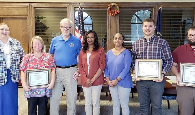 TEACHERS OF THE MONTH – Fulton Independent Schools named their August and September Teachers of the Month at their monthly board meeting Oct. 9. Pictured from left are, Superintendent Dr. DeAnna Miller; Teacher Alley Evans for September; Board Vice-Chair Bill Robertson; Board member Carol Bransford; Board Chair Debbie Vaughn; Teacher Matthew Moxley for August; and Teacher Joseph Dublin for September. (Photo by Barbara Atwill)
