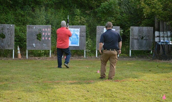 """Participants in the Fulton Police Department's Banana Festival Pistol Shoot also had the opportunity to enter a """"Turkey Shoot"""" on Saturday, aiming for playing cards attached to targets. (Photos by Benita Fuzzell.)"""