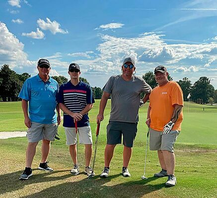 PREMIER PLACES THIRD – Premier Portable Buildings Team # 4, donated their third place winnings back to the Chamber during the annual fundraiser golf scramble held Oct. 2. Pictured left to right are team members Chris Johnson, Dustin Johnson, Kenny Johnson and Kevin Irons. (Photo submitted)