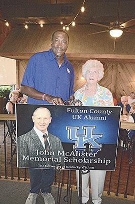 "WILDCAT PRIDE – Bettie McAlister was in attendance for the recent Fulton County UK Alumni banquet, and visited with guest speaker Jack ""Goose"" Givens. Her late husband, John McAlister, an avid supporter of the UK Wildcats and the local Alumni organization, has been memorialized with the annual scholarships presented bearing his name. (Photo by Benita Fuzzell)"