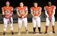 HONORED PLAYERS – South Fulton High School held Senior Night ceremonies on Friday night. Playing their last regular season game for the Red Devils football team was Josey McIntyre (52), Harley Davis (56), Caleb Little (28) and Micheal Reeves (1). (Photo by Charles Choate)