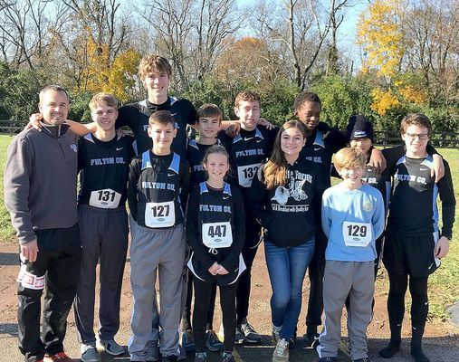 STATE COMPETITORS – Fulton County's Cross Country team members attending the Kentucky State Cross Country Meet at New Horse Park in Lexington on Nov. 3 were front row, from left, Daniel Collins, Emma Madding, Callie Coulson, and Logan Griffith; back row, from left Coach Jamie Madding, Isaac Madding, Camden Aldridge, Chade Everett, Hayden Murphy, Wesley Brown, Harrison Posey, and Luke Jackson. (Photo submitted)