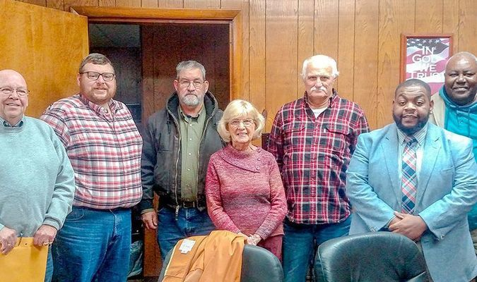 SWEARING IN – Newly elected city officials were sworn in following the Clinton City Council meeting Dec. 3. Pictured, left to right, are Council members Tommy Kimbro, Chad Frizzell, Mayor Fred Cox, Council members Betty Morrow, John Kelly, Alex Thomas, and Howard Dillard. (Photo by Becky Meadows)