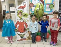 DECEMBER'S TOP HCES STUDENTS – As Christmas approaches, Hickman County Elementary School went all Grinch to recognize its Students of the Month for December. The character trait emphasized in December was Obey the Rules, so students tried to help The Grinch understand that following rules is important. Preschool students of the month selected by teachers include, left to right, Kenedy Allen, Everleigh Black (Grinch), Cierra Moss, Jiovanny Colon, and Alaina Brann. Not pictured is Whitley Jo Tucker. (Photo submitted)