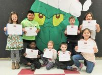 HCES STUDENTS OF THE MONTH – As Christmas approaches, Hickman County Elementary School went all Grinch to recognize its Students of the Month for December. The character trait emphasized in December was Obey the Rules, so students tried to help The Grinch understand that following rules is important. Primary students of the month chosen by teachers include, front row, left to right, Caleb Jeffrey, Katelyn McCarty, Thomas Lee, and Allyson Wilson; back row, Ailey Farmer, Gavin Limones, Aiden Becker, and Bailyn Garcia. (Photo submitted)