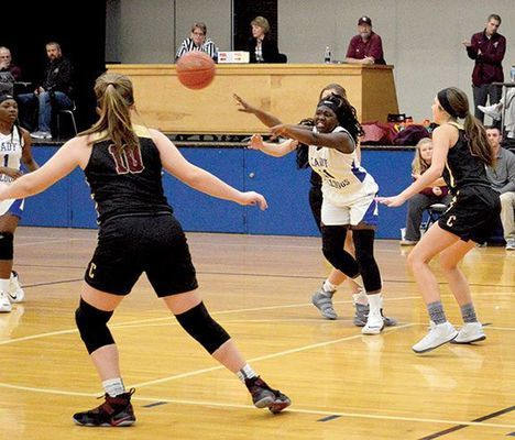 LADY BULLDOGS FACE-OFF WITH LADY COMETS – Ca'Tya McManus makes the pass in a home court match-up versus Carlisle Co. Lady Comets Dec. 11. FHS lost the game 57-37. (Photo by Benita Fuzzell)